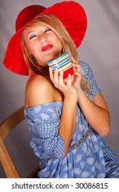 Blonde teenaged girl drinking coffee from ceramic cup
