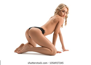 Blonde topless staying on her knees shot
