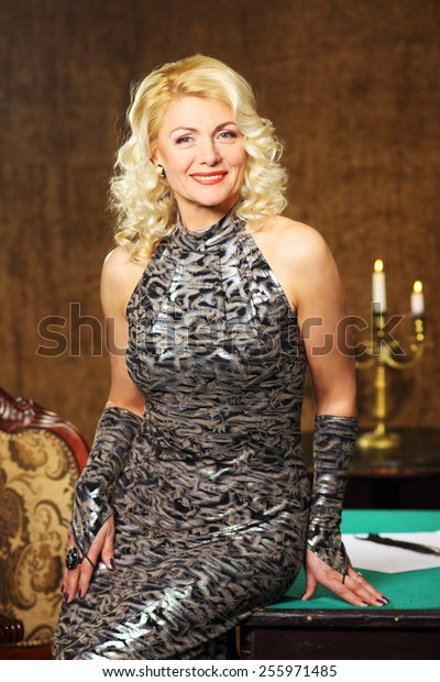 blonde Vintage fashion Senior woman in vintage evening dress. Beautiful woman retro portrait