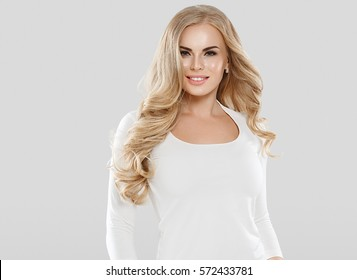 Blonde woman beautiful girl with long hair studio portrait.