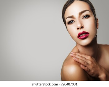 Blonde Woman Beauty Skincare Portrait with Copy-space. Beautiful Woman with perfect Hair and Make-up