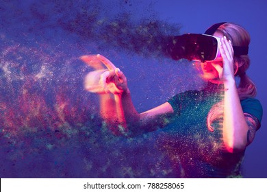 Blonde woman being blown away by the virtual reality. Conceptual image