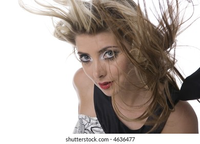 Blonde woman with big blue eyes and hair blowing in the wind, isolated on white