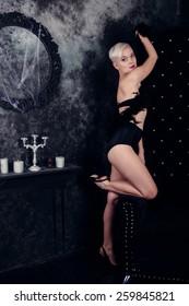 Blonde woman in black underwear