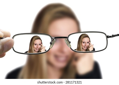 blonde woman blurred seen correctly through glasses