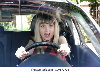 Blonde woman in car