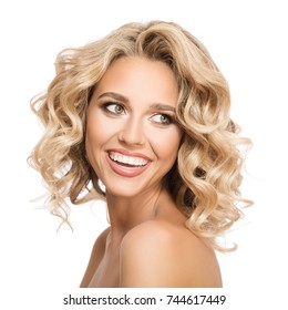 Blonde woman with curly beautiful hair smiling on white background. Isolated.