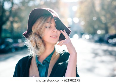 Blonde woman dreaming in hat closeaup fashion outdoors lifestyle