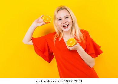 Blonde woman in dress with oranges