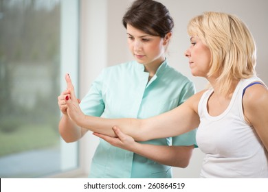 Blonde woman during rehabilitation after wrist injury