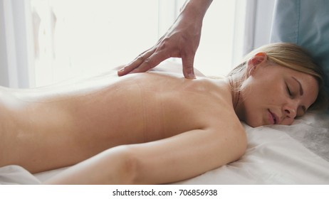 Blonde woman is given a massage. Tibetan Medicine
