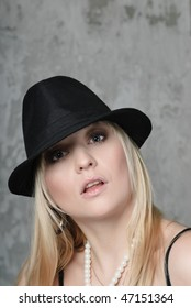Blonde woman and hat- close-up eyes