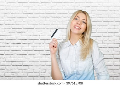 blonde woman holding credit card