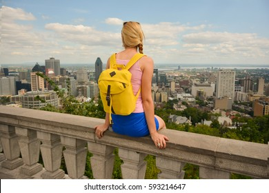 Blonde woman looking at Montreal downtown skyline cityscape. Canada.