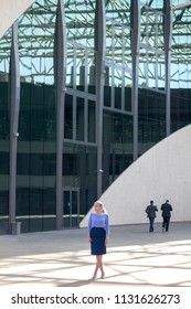 Blonde woman in a modern building