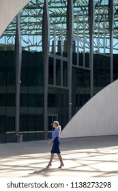 Blonde woman on a background of modern architecture