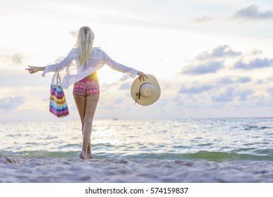 Blonde Woman on the beach at sunset