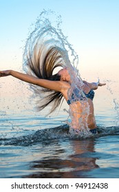 blonde woman on water background