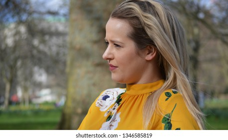 blonde woman in park