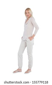 Blonde woman posing for the camera on a white background
