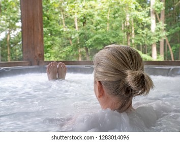 Blonde woman relaxing in hot tub