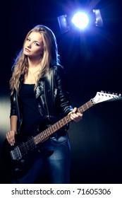 blonde woman rock star portrait with guitar