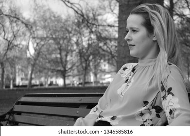 blonde woman sad in park
