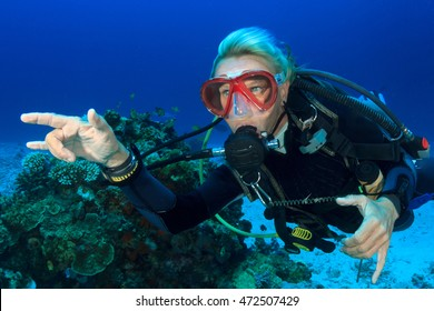 Blonde woman scuba diver close up