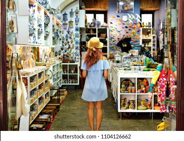Blonde woman in souvenir shop in Lisbon, Portugal