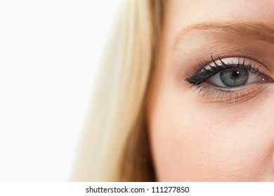 Blonde woman staring at the camera against a white background