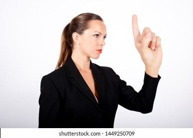 blonde woman in suit holding up her huge hand as a warning