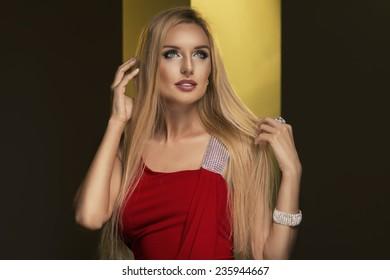 Blonde woman wear red dress