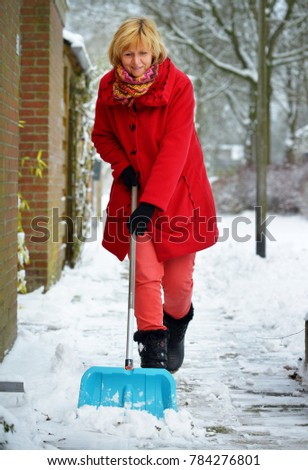 a2e9d3972 Blonde Woman Wearing Red Coat Red Stock Photo (Edit Now) 784276801 ...
