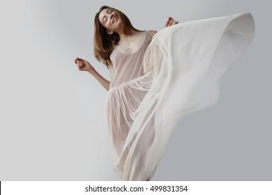blonde woman wears transparent dress of ballerina. blowed dress by wind