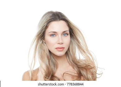 blonde woman with wind moved long hair and blue eyes front portrait
