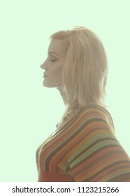 Blonde women in backlight,1960 - 1970 style, profile. She is dressed in a knitted blouse in a strip, on her neck she has a beautiful necklace. A clean white background. Isolated image. Side view.