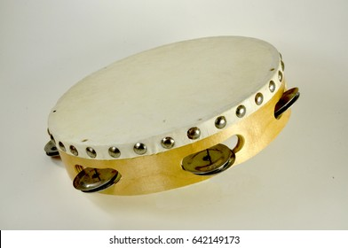Blonde wooden tambourine with single row of metal jingles