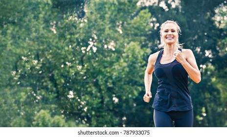 Blonde young woman running in the park