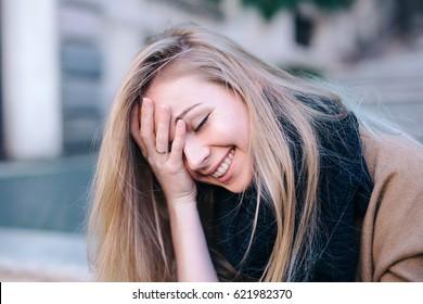 Blonde young woman smiling laughing fashion emotional