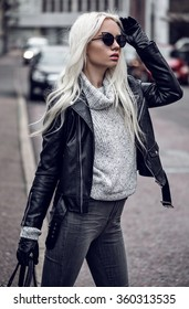 Blonde young woman walking outdoors
