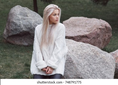 Blondhair beautiful female weared in knitted white sweater
