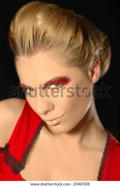 Blondie with bright red makeup