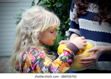 Blondie little girl with lemons