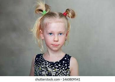 blong little girl looking at camera studio portrait