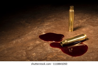Blood around a pair of empty assault rifle bullets on a beige floor tile