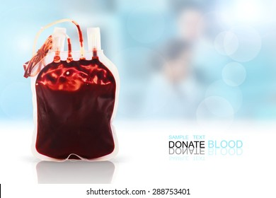 blood bag on the Glossy white table in front of the laboratory blurred background.World AIDS day