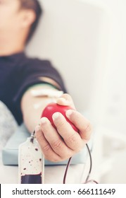 Blood donor at donation with a bouncy ball holding in hand.Also concept image for World blood donor day-June 14
