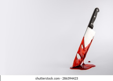 Blood drenched Kitchen knife in pool of blood with copy space