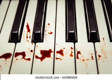 blood drop on piano key,dirty.