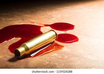 Blood and an empty cartridge for an assalt rifle on the floor